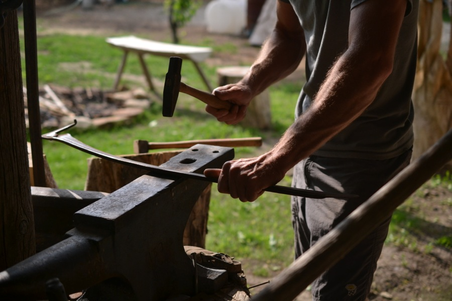 peening a salvaged scythe blade