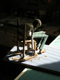 Laceroot in his rocker in the workshop