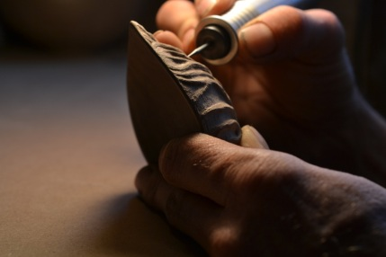 carving a walnut spoon